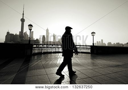 Chinese Man Walking Outdoors Concept