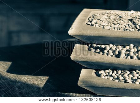 Legumes in wooden containers. legumes are an excellent food, very complete for this reason they are good substitutes for meat, fish.