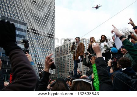 NEW YORK-JAN 12: Charlie Todd, founder of Improv Everywhere, speaks at the 13th annual international 'No Pants Subway Ride' at Foley Square January 12, 2014 as drone hovers overhead in New York City.