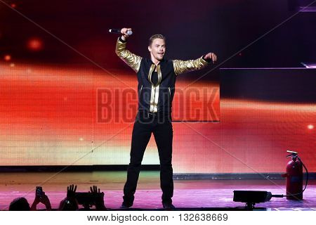 NEW YORK-JUL 9: Derek Hough performs on stage during the Move Live On Tour at Radio City Music Hall on July 9, 2015 in New York City.
