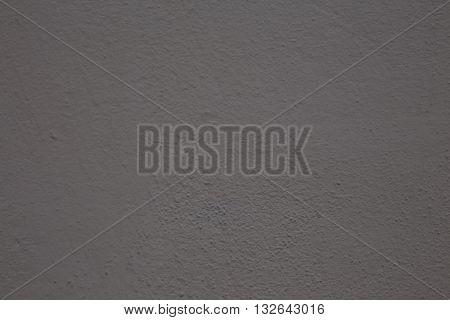 A medium dark grey pebble background that is blank