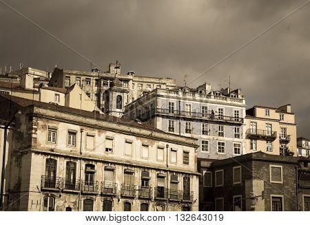 Dark cloudy skies behind a building in lisbon