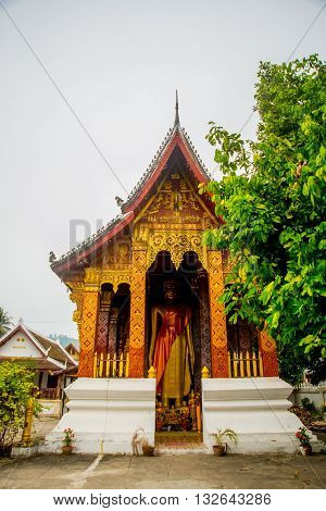 Buddhist Temple With Gold.the Gold Buddha Statue.luang Prabang.laos.