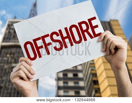 Offshore placard with urban background