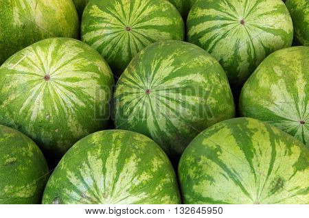 Detail of watermelons stacked at market place