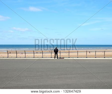 New promenade at Blackpool with man viewing the sea