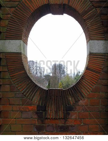 Garden window with oval sha tiled surround