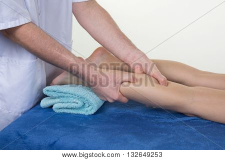 Man Hands Massaging Woman Calf Muscle.therapist Applying Pressure On Leg.