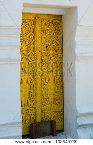 The Door And Wall Painting.buddhist Temple With Gold.luang Prabang.laos.