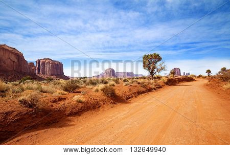 red dirt road in rocky desert scenery