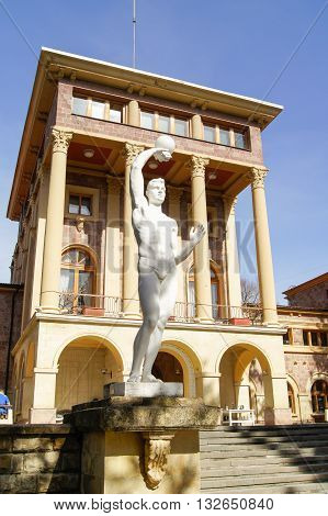 Kislovodsk, Russia - 28 February, Statue of man with a ball on the background of the house, 28 February, 2016. Resort zone Mineral Waters, Krasnodar region.