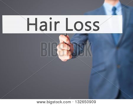 Hair Loss - Businessman Hand Holding Sign