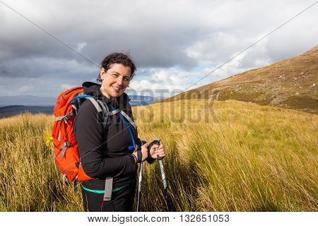 Smiling Woman Hiker Posing At The Foot Of Carrauntoohil