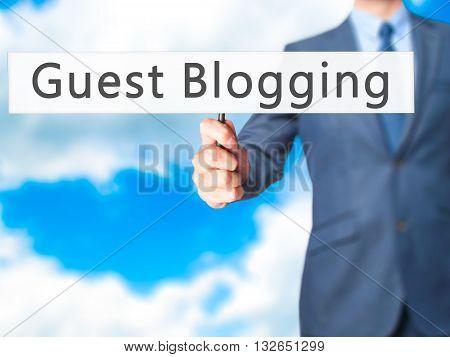 Guest Blogging - Businessman Hand Holding Sign