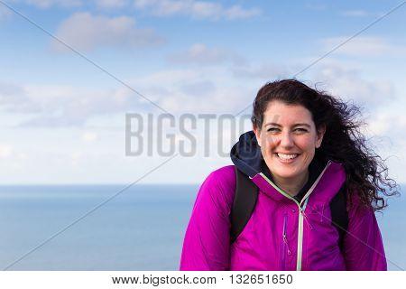 Beautiful Smiling Woman Wearing A Purple Jacket