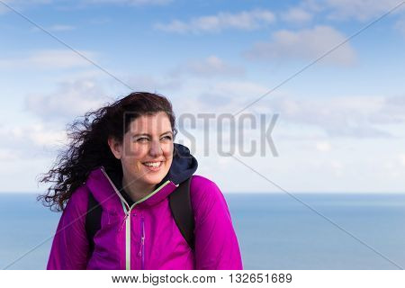 Beautiful Smiling Female With Her Hair Waving The Wind