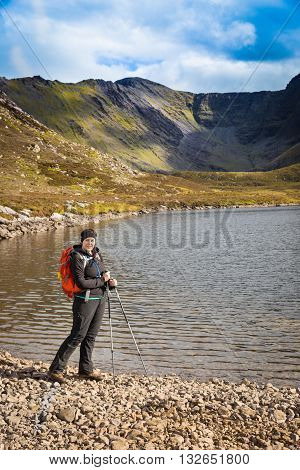 Woman Hiker Posing Lake Side In The Mountains
