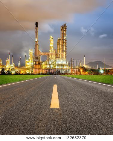 Oil refinery and asphalt road at twilight.