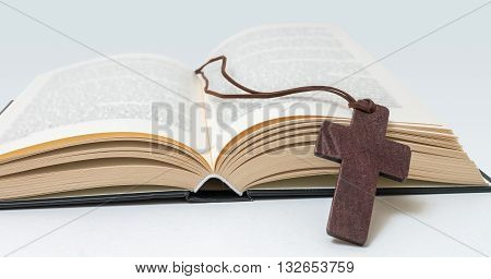 Holy Bible and Brown cross. Religion concept.