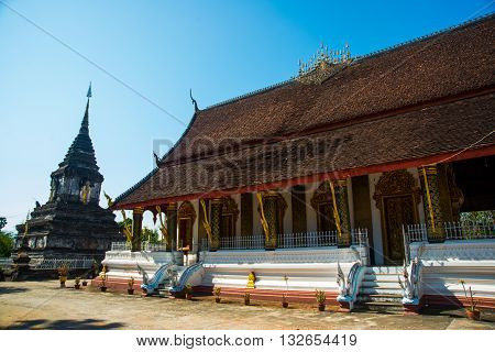 Buddhist Temple. The Roof Of The Temple.luang Prabang.laos.ddhist Temple With Gold.luang Prabang.lao