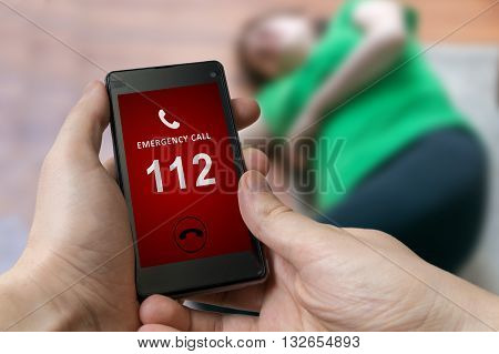 Man Dialing Emergency (112 Number) On Smartphone. Woman Had Hear