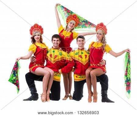 Dancer team wearing a folk costumes dancing. Isolated on white background in full length.