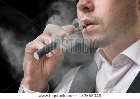Young Caucasian Man Is Vaping With Electronic Cigarette Or Vapor