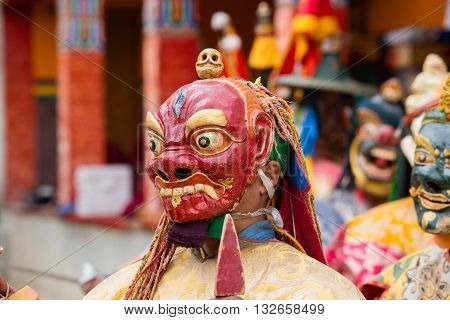 LAMAYURU INDIA - JUNE 13 2015: Unidentified buddhist lamas dressed in mystical mask dancing Tsam mystery dance in time of Yuru Kabgyat Buddhist festival at Lamayuru Gompa Ladakh North India