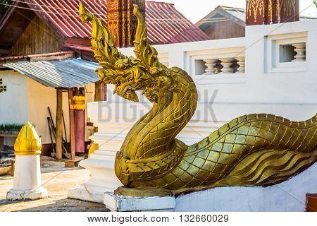 The Sculpture Of The Golden Dragon.luang Prabang.laos.