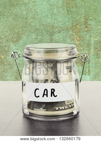 Jar for savings full of banknotes on wooden background