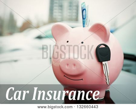 Car insurance concept. Piggy money box with cash and key on car bonnet at the street