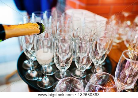 Pour Champagne Into Glasses At Wedding Party