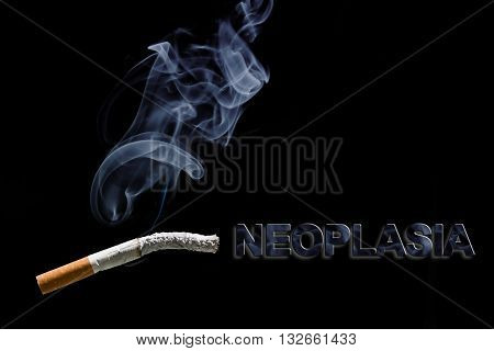 Burned cigarette and text neoplasia on black background