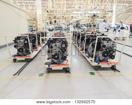 PRACHINBURI Thailand - May 12 2016: Employees of Honda Automobile Thailand work on a automobile assembly line of Honda engine at Prachinburi plant in Rojana Industrial Park.