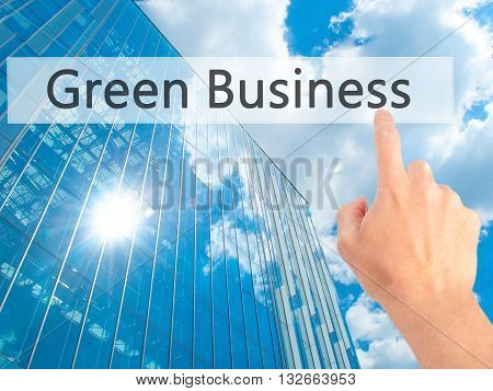 Green Business  - Hand Pressing A Button On Blurred Background Concept On Visual Screen.
