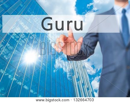 Guru - Businessman Hand Pressing Button On Touch Screen Interface.
