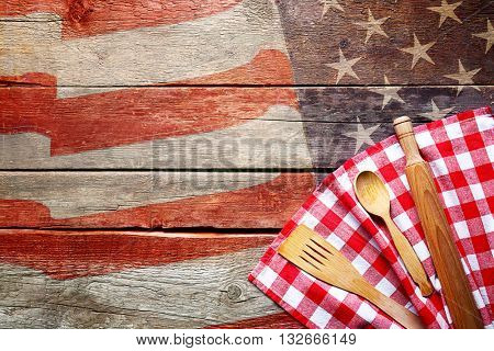 Checkered napkin and cutlery on wooden background. American cuisine food concept