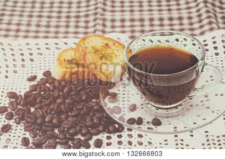 Cup of coffee and homemade garlic bread vintage style