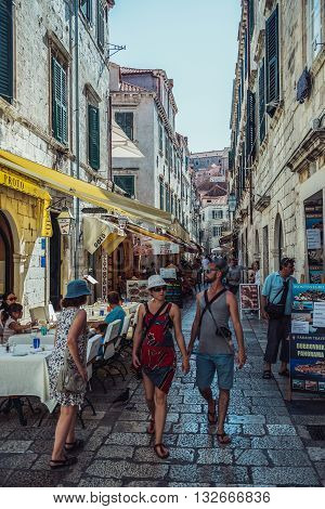 Dubrovnik Croatia - August 26 2015. Tourists walks on a small street on the Old Town of Dubrovnik