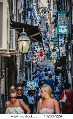 Dubrovnik Croatia - August 26 2015. Tourists walks on a small street with lot of stairs on the Old Town of Dubrovnik