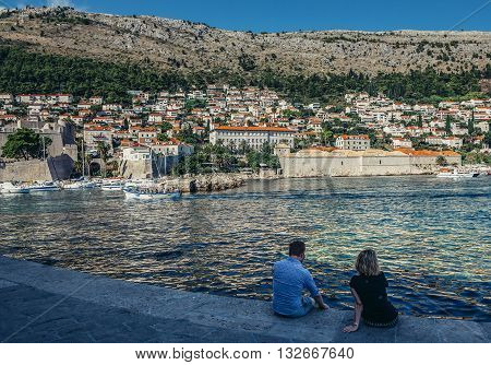 Dubrovnik Croatia - August 26 2015. Man and woman looks at Dubrovnik's hills seen from Old Town Harbour