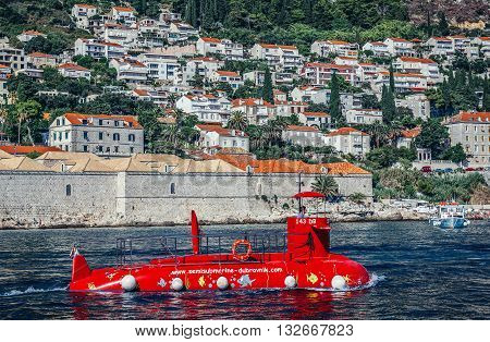 Dubrovnik Croatia - August 26 2015. Red semi submarine for tourists seen from Old Town Harbour in Dubrovnik