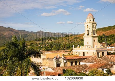 The tower of the San Francisco Convent in the historic center of the colonial city of Trinidad Cuba with view on surrounding hills