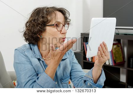 mom making a distant call on internet with her family