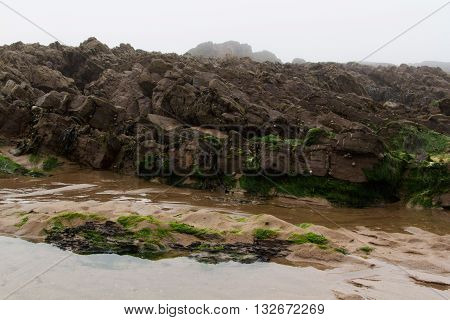 Water Left Stranded In The Rocks By Low Tide