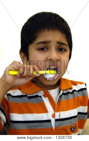 Kid Brushing His Teeth