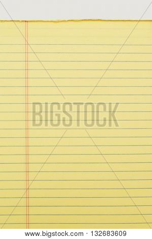 Close up of yellow note pad isolated on white background