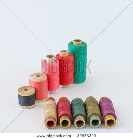 Colored thread for sewing on wood and paper reels