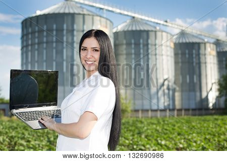 Woman Agronomist In Front Of Silo