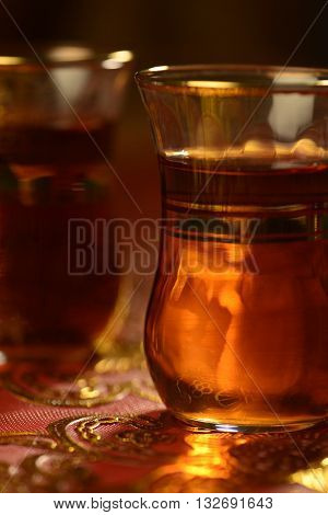 Popular Arabian hot black tea in a traditional tea cups.